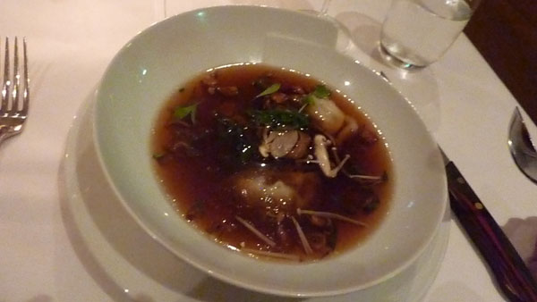Peking duck consommé with duck dumplings and mushrooms
